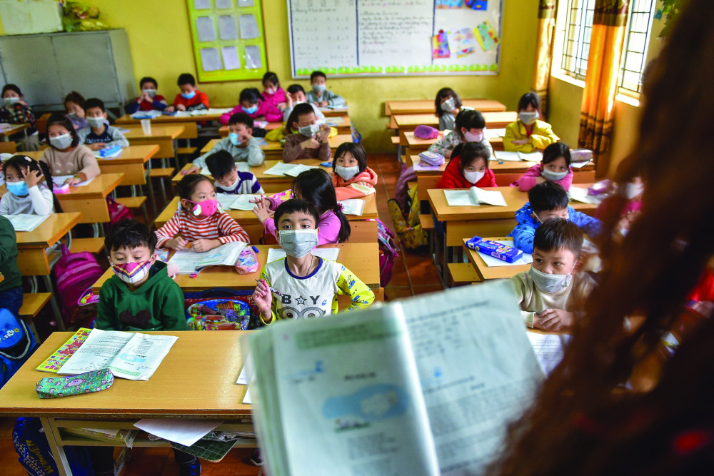 Họ c sinh Trườ ng tiể u họ c Tả Thanh Oai (Hà Nộ i) đeo khẩ u trang trong giờ họ c (ả nh chụ p ngà y 31/1/2020) ẢNH: TOÀN VŨ (DANTRI.COM.VN)