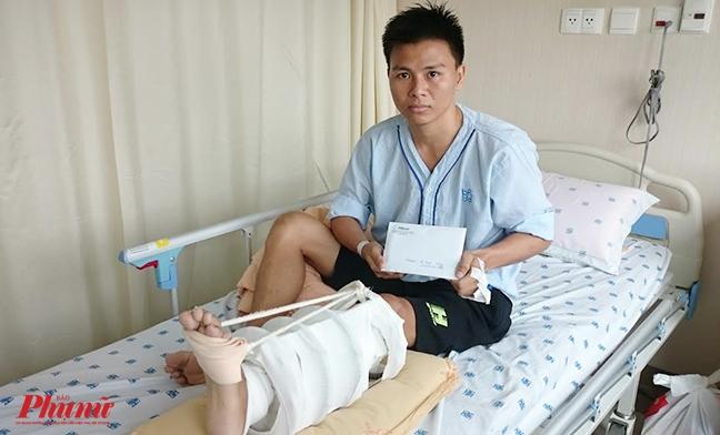 Bao Phu Nu TP.HCM trao gan 30 trieu dong cua doc gia den vo su co nguy co phai cua chan