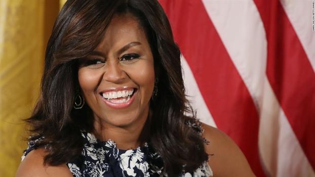 Michelle Obama - nguoi chua lanh vet thuong mau da