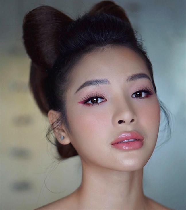 Phuong Trinh Jolie lang xe mot bui toc hinh no la mat