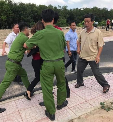 Điều tra hành vi 'hủy hoại tài sản' những người mặc đồng phục địa ốc Alibaba